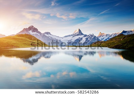 Great view of the snow rocky massif. Popular tourist attraction. Dramatic and picturesque scene. Location place Bachalpsee in Swiss alps, Grindelwald valley, Bernese Oberland, Europe. Beauty world. #582543286