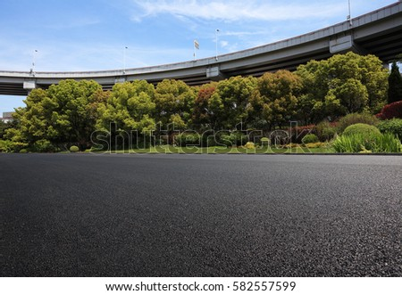 Empty road floor surface with city viaduct overpass bridge background #582557599