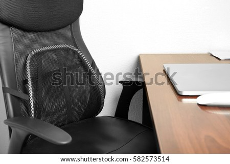Office chair with mesh for back support  on white wall background #582573514