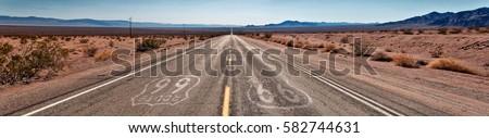 Route 66 to Joshua Tree National Park - Panorama Shot Royalty-Free Stock Photo #582744631