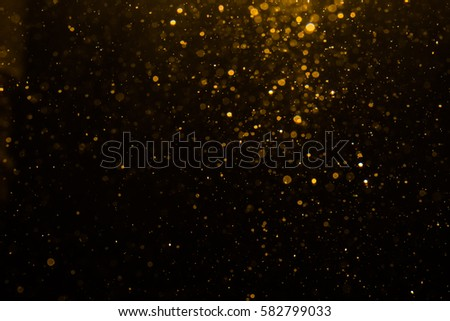 Abstract gold bokeh with black background #582799033