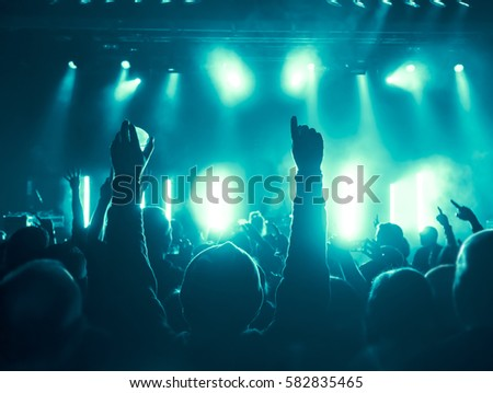 cheering crowd at a rock concert #582835465