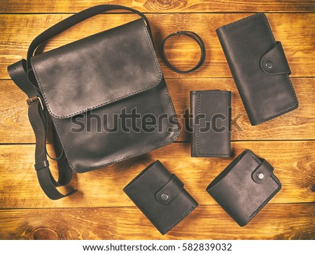 Men's accessories on the wooden table Royalty-Free Stock Photo #582839032