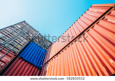 Containers box from Cargo freight ship for import export,logistic concept Royalty-Free Stock Photo #582850552