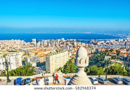 The Carmel Mount is the best city's viewpoint, overlooking old and modern districts, port and coast of Marseille, France. #582968374