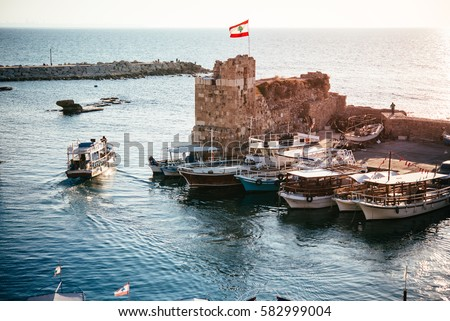 View of the boats in the harbour of Byblos, Lebanon. Royalty-Free Stock Photo #582999004