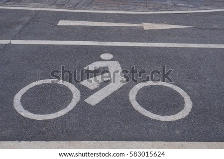Bike sign on road floor. #583015624
