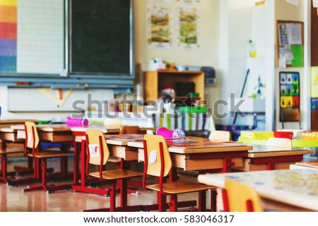 Elementary classroom, back to school concept Royalty-Free Stock Photo #583046317