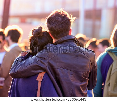 A couple in a concert. Royalty-Free Stock Photo #583061443