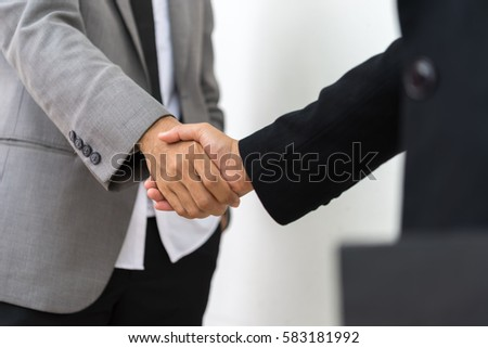 Business people shake hand for business  partnership  and friendship. #583181992