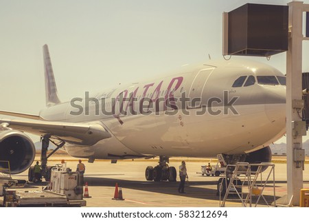 ATHEN, GREECE - JULY 24, 2016: Qatar plane at Athens International Airport, aircraft docked at the gate. Vintage style. #583212694