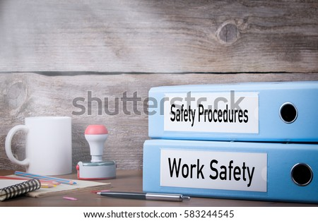 Work Safety and Safety Procedures. Two binders on desk in the office. Business background #583244545