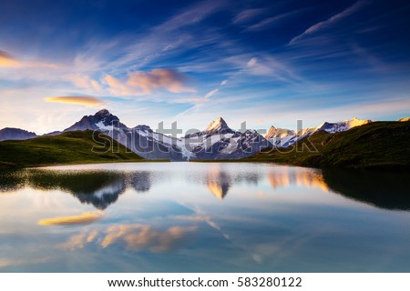 Great view of the snow rocky massif. Popular tourist attraction. Dramatic and picturesque scene. Location place Bachalpsee in Swiss alps, Grindelwald valley, Bernese Oberland, Europe. Beauty world. #583280122