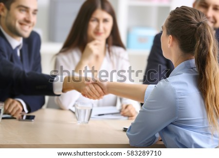 Job applicant having interview in office Royalty-Free Stock Photo #583289710