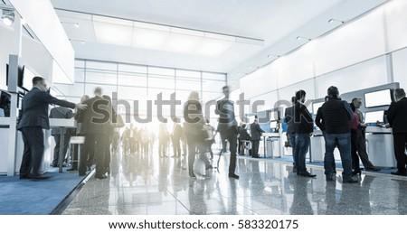 Tradeshow Visitors at Trade Fair Stands Royalty-Free Stock Photo #583320175