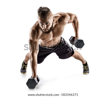 Handsome man doing  exercise with dumbbells. Photo of muscular man isolated on white background. Strength and motivation. #583346371