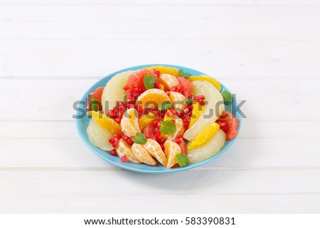 plate of fruit salad on white background #583390831