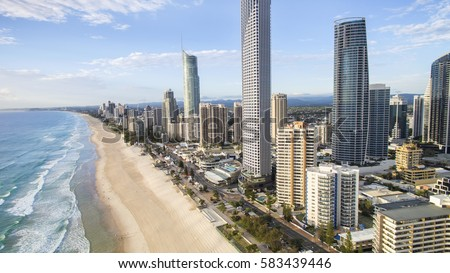 Aerial view looking down to Gold Coast Surfers Paradise cityscape and famous beach. #583439446