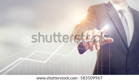 Development and growth concept. Businessman plan growth and increase of positive indicators in his business. Royalty-Free Stock Photo #583509967
