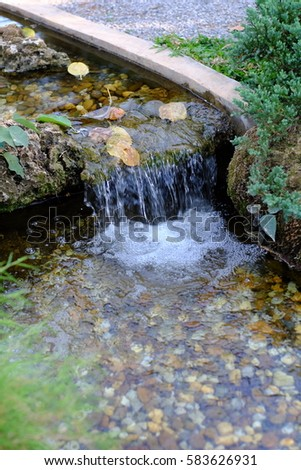 waterfall in the garden. #583626931