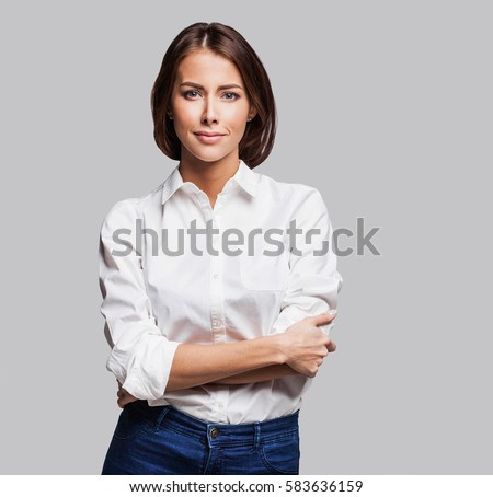 Beautiful young woman portrait. Studio shot, isolated on gray background Royalty-Free Stock Photo #583636159