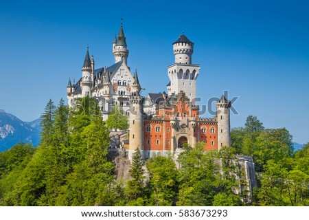 Beautiful view of world-famous Neuschwanstein Castle, the nineteenth-century Romanesque Revival palace built for King Ludwig II on a rugged cliff, with scenic mountain landscape, Bavaria, Germany #583673293