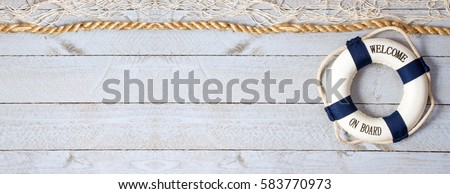 Welcome on Board - lifebuoy with text on horizontal wooden background texture, copy space for individual text Royalty-Free Stock Photo #583770973