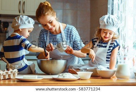 happy family in the kitchen. mother and  children preparing the dough, bake cookies #583771234