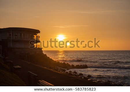 Westward Ho! Sunset at the Pier House Royalty-Free Stock Photo #583785823