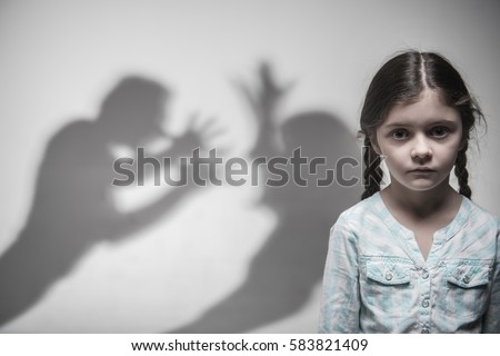 Silhouette of parents expressing quarrel Royalty-Free Stock Photo #583821409
