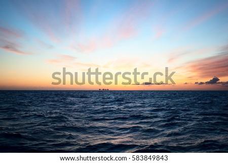Sunset over sea #583849843