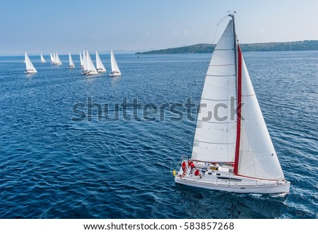 Racing sail boat from bird view, many of sailing boats in background Royalty-Free Stock Photo #583857268
