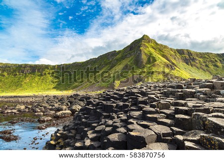 Giant's Causeway in a beautiful summer day, Northern Ireland Royalty-Free Stock Photo #583870756