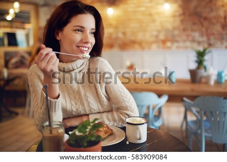 woman in a cafe drinking coffee #583909084