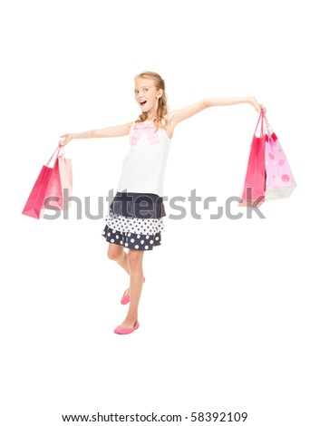happy girl with shopping bags over white #58392109
