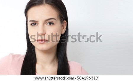 Beautiful woman face close up portrait young studio on gray #584196319