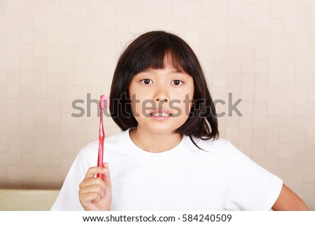 Relaxed girl with a toothbrush #584240509