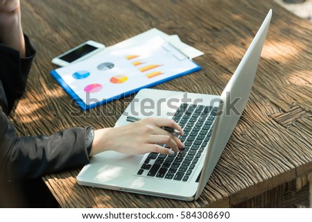 Businesswoman working with a notebook computer. #584308690