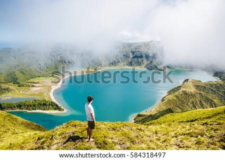 Tourist over Lagoa do Fogo São Miguel Açores #584318497