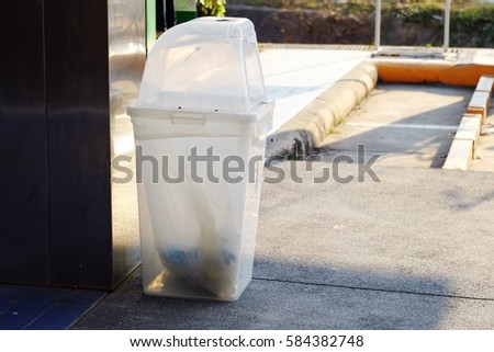 White plastic trash bin  #584382748