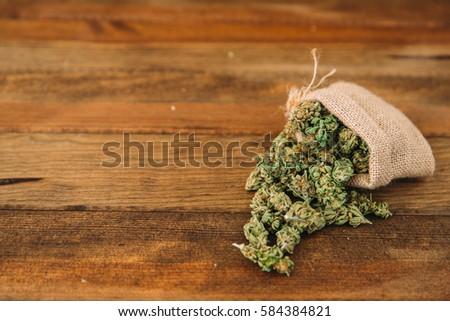Detail of cannabis buds. Skunk. Marijuana on wooden background