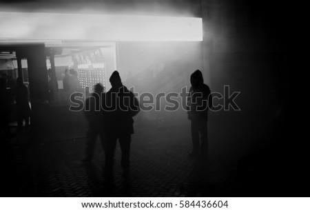 Shadows in the city fog #584436604