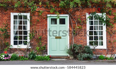 View of a Beautiful House Exterior and Front Door Seen on a London Street Royalty-Free Stock Photo #584445823