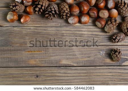 Hazelnut on wooden background #584462083
