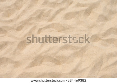 Fine beach sand in the summer sun Royalty-Free Stock Photo #584469382