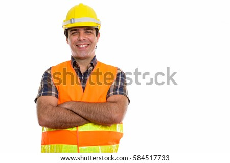 Studio shot of young happy Persian man construction worker smiling with arms crossed #584517733