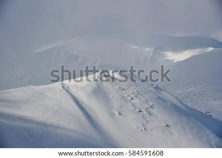 Snow-bound mountain landscape. Mountain landscape. #584591608