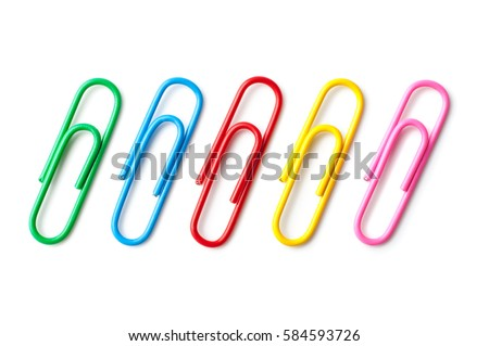 Colored paper clips close-up on a white background Royalty-Free Stock Photo #584593726