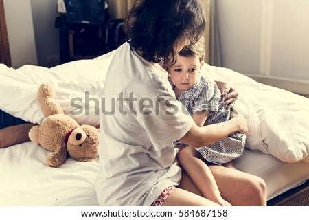 Mother hug and consoling the little boy from nightmare Royalty-Free Stock Photo #584687158