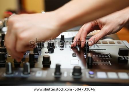 Dj mix music.Disc jockey play tracks on audio mixer controller.Professional hip hop musician audio equipment for night club party. #584703046